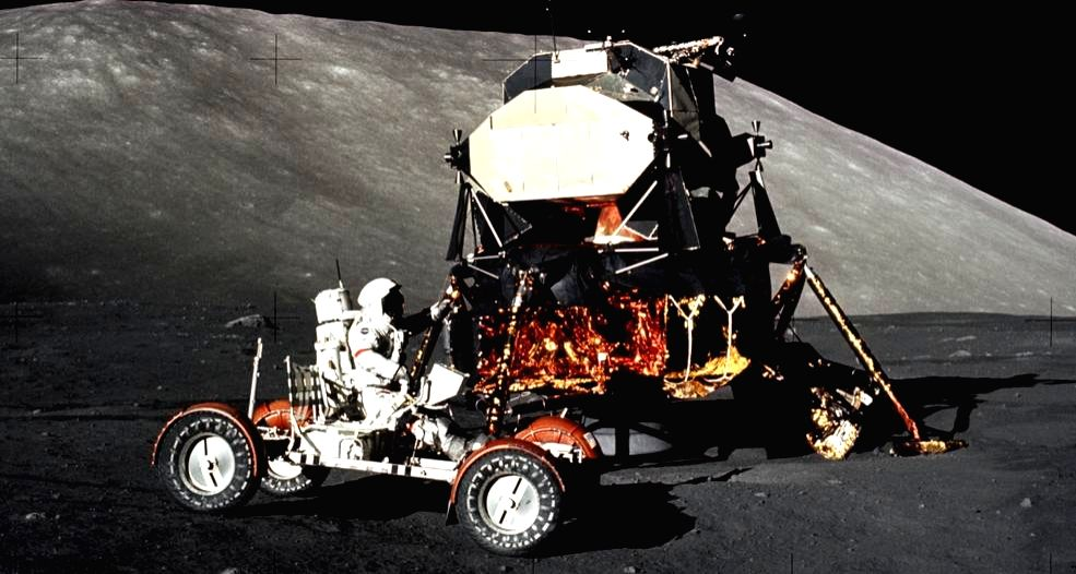 Apollo 17 mission commander Eugene Cernan drives the lunar roving vehicle during the early part of the first moonwalk at the Taurus-Littrow landing site. The Lunar Module is in the background. (Photo: NASA/Harrison Schmitt)