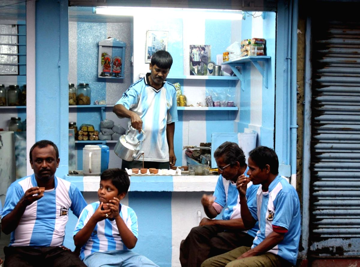 Ardent Argentina supporters sipping Chai  at a local tea stall in India