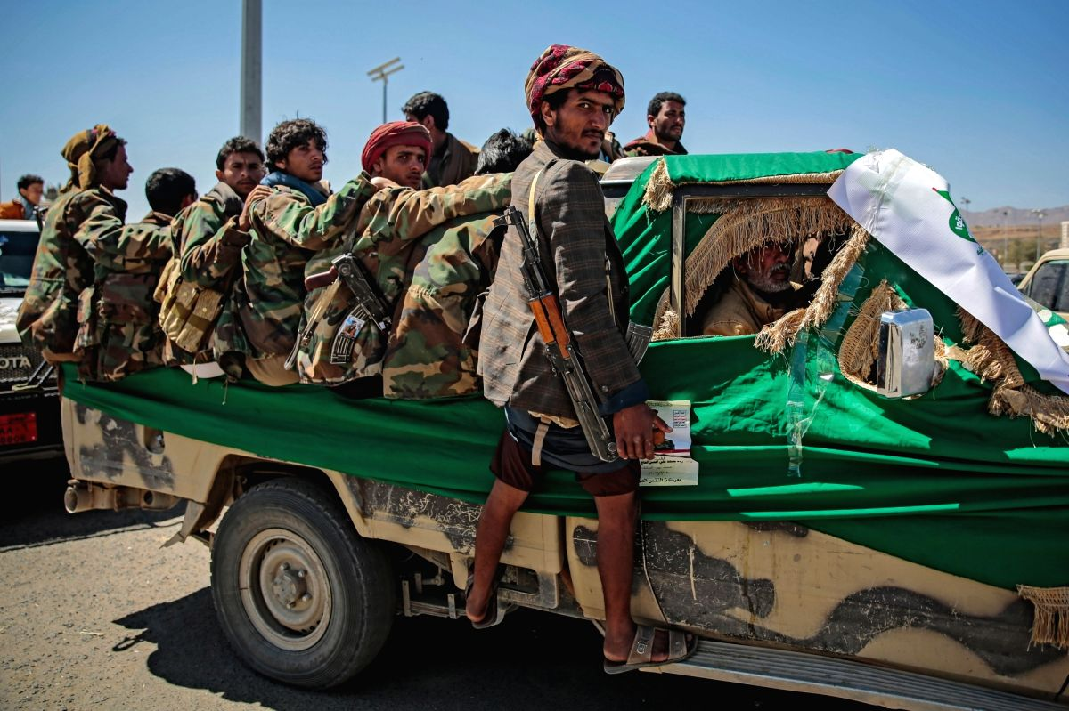 Armed members of the Houthi rebel movement ride a vehicle during a funeral procession on March 9. Photo: Hani Al-Ansi/dpa/IANS