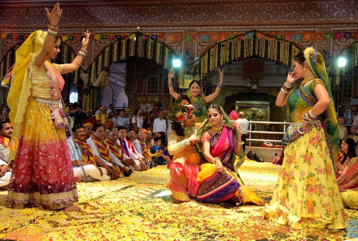 Artists depicting as Radha-Krishna perform the Braj ki Holi at Govinddevji Temple in Jaipur.