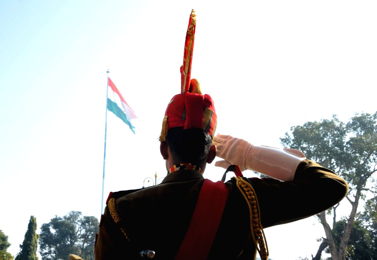 A Border Security Force (BSF) soldier salutes the national flag during India's 70th Republic Day celebrations at the Attari-Wagah border in Punjab