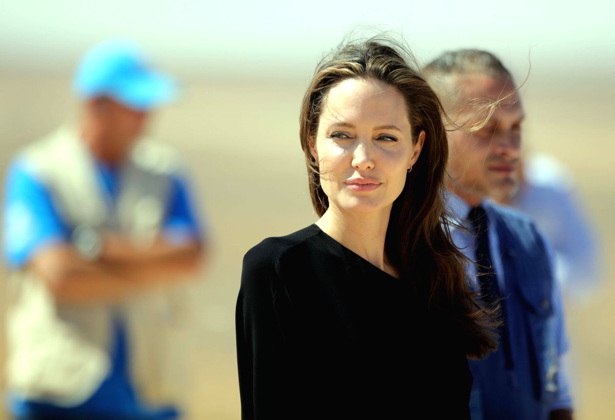 AZRAQ, Sept. 9, 2016 (Xinhua) -- U.S. actress and special envoy to the United Nations High Commissioner for Refugees(UNHCR) Angelina Jolie is seen during her visit to a Syrian refugee camp in Azraq, Jordan, on Sept. 9, 2016. (Xinhua/Mohammad Abu Ghos