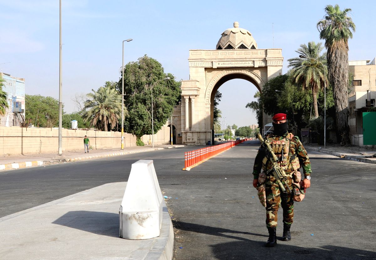 BAGHDAD, June 4, 2019 (Xinhua) -- A security member guards an entrance to the Green Zone, Baghdad, Iraq, on June 4, 2019. For the first time since the U.S.-led invasion in 2003, main streets in Baghdad's heavily-fortified Green Zone were fully opened