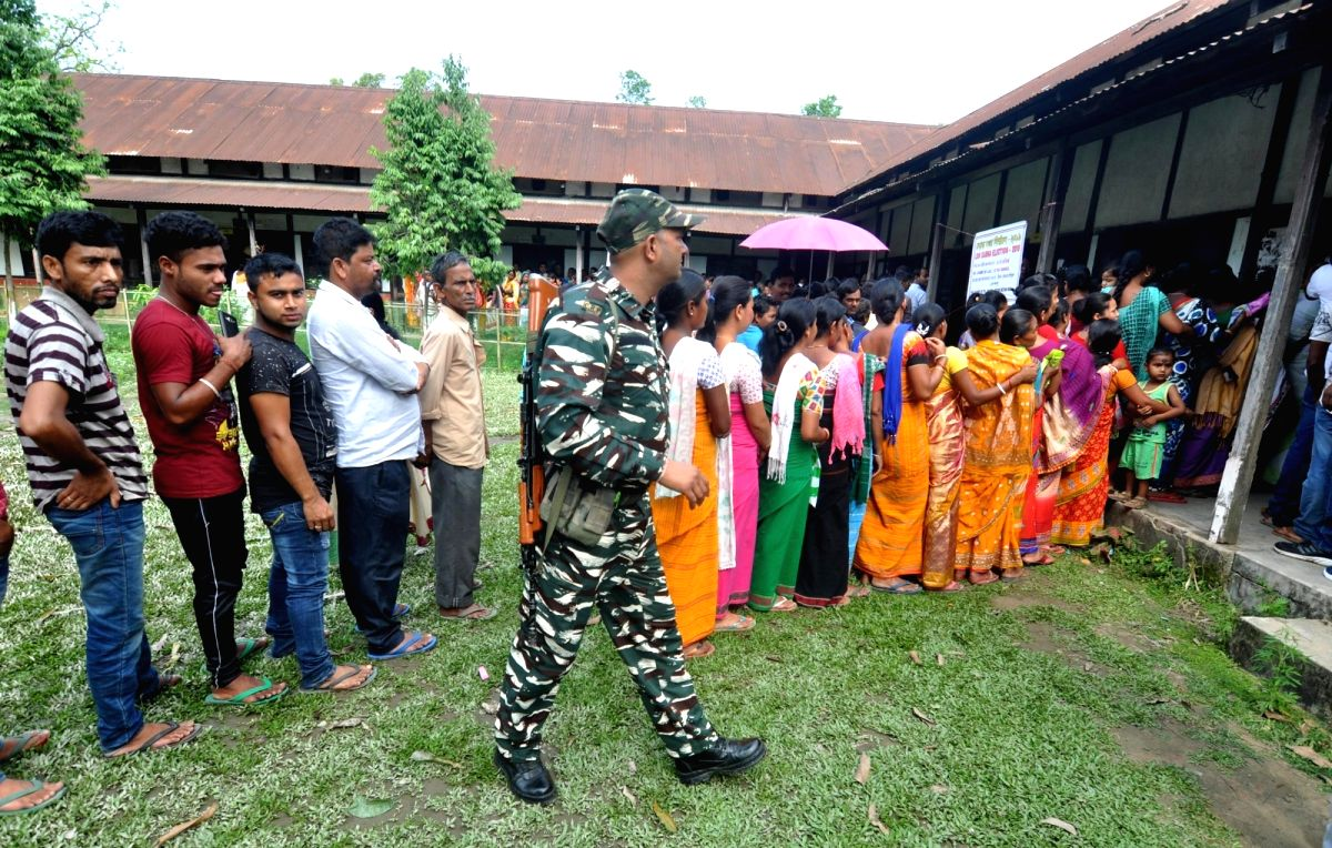 Baksa: People wait in a queue to cast their votes for the second phase of 2019 Lok Sabha elections, at a polling station at Baska in Baksa District of Assam, on April 18, 2019.