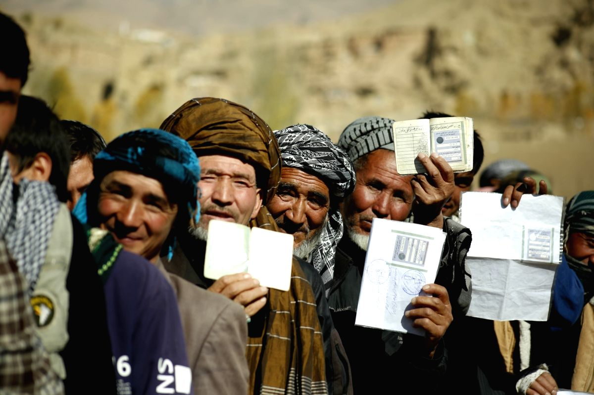 Voters wait to cast their ballots at a polling station during parliamentary elections in Bamyan, Afghanistan