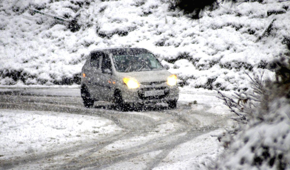Baramulla: A four-wheeler wades through a road during snowfall in Jammu and Kashmir's Baramulla on Nov 23, 2020.