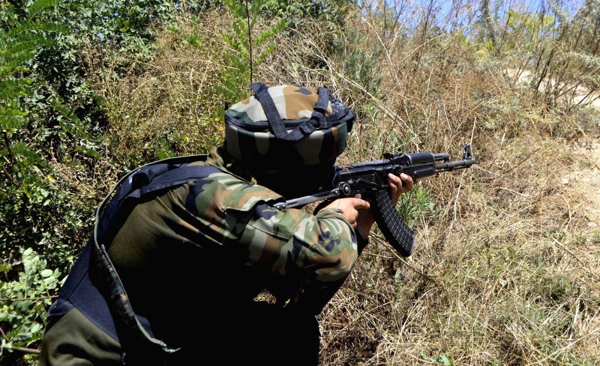 Baramulla: An army personnel takes position during an encounter between the security forces and terrorists in North Kashmir's Baramulla district on Aug 22, 2020. One terrorist was killed in the encounter. The encounter erupted after a joint team of t