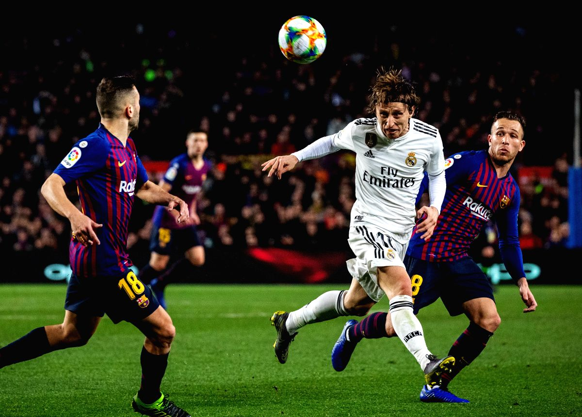 BARCELONA, Feb. 7, 2019 (Xinhua) -- Real Madrid's Luka Modric (2nd R) competes with FC Barcelona's Arthur Melo (1st R) during the Spanish King's Cup semifinal first leg match between FC Barcelona and Real Madrid in Barcelona, Spain, on Feb. 6, 2019.