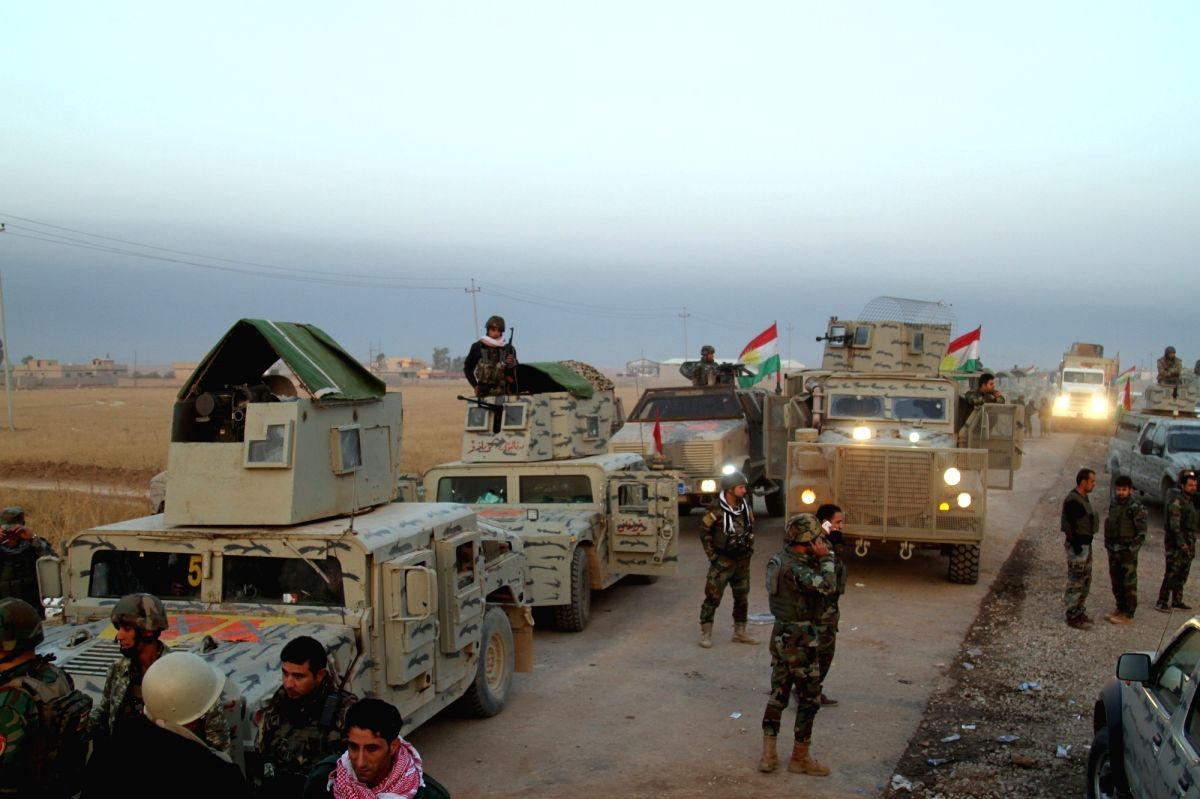 BASHIQAH (IRAQ), Nov. 7, 2016 (Xinhua) -- Kurdish security forces, known as Peshmerga, assemble outside the town of Bashiqah, some 30 km northeast of Mosul, Iraq, on Nov. 7, 2016. Kurdish security forces, known as Peshmerga, freed Monday a town from