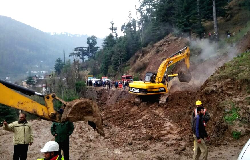 Batote: Earthmovers pressed into service at the site of landslide in Jammu and Kashmir's Batote on March 20, 2016. The traffic on Srinagar-Jammu National Highway is stalled for the fourth consecutive day due to the landslide.