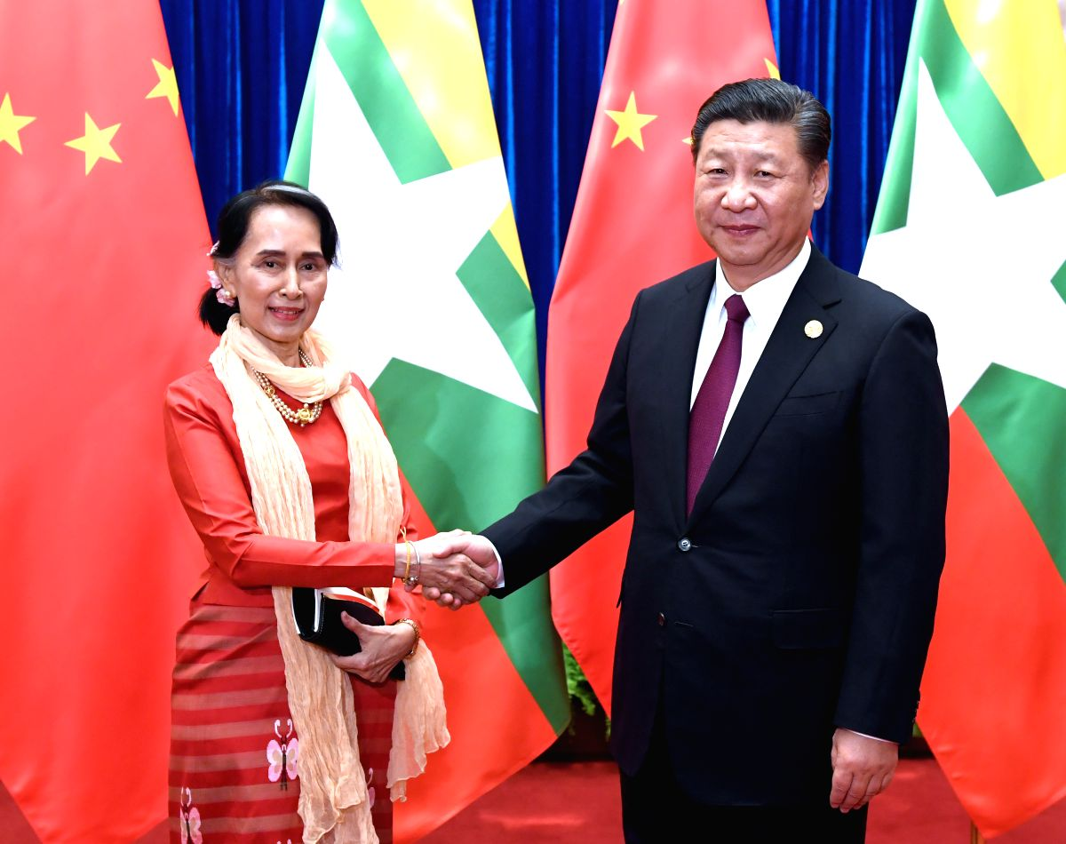 BEIJING, Dec. 1, 2017 (Xinhua) -- Chinese President Xi Jinping (R), also general secretary of the Communist Party of China (CPC) Central Committee, meets with Myanmar State Counselor Aung San Suu Kyi, who is here to attend the CPC in Dialogue with Wo