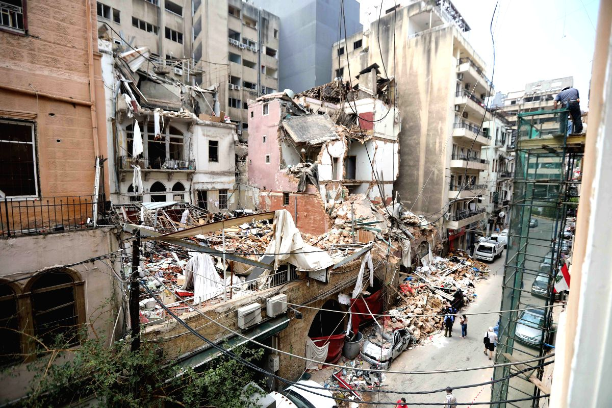 Beirut, Aug. 13, 2020 (Xinhua) -- The ruins of damaged buildings are seen in Beirut, Lebanon, Aug. 13, 2020. Beirut's governor previously announced that 300,000 people have become homeless following the explosions with many of them unable to afford f