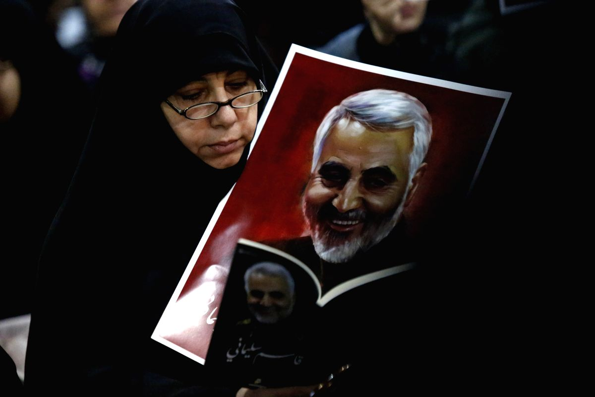 BEIRUT, Jan. 5, 2020 (Xinhua) -- A supporter holds a portrait of Qassem Soleimani during a rally in southern suburbs of Beirut, Lebanon, on Jan. 5, 2020. Hezbollah leader Sayyed Hassan Nasrallah urged on Sunday its fighters to attack U.S. soldiers in