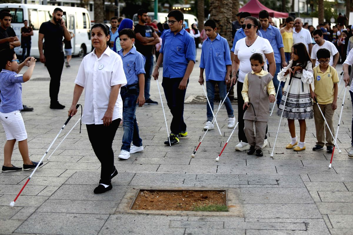 BEIRUT, Oct. 16, 2019 (Xinhua) -- A group of blind people take part in the White Cane Safety Day event held in Beirut, Lebanon, on Oct. 16, 2019. Some welfare institutions in Lebanon organized activities for people with visual handicaps on Wednesday