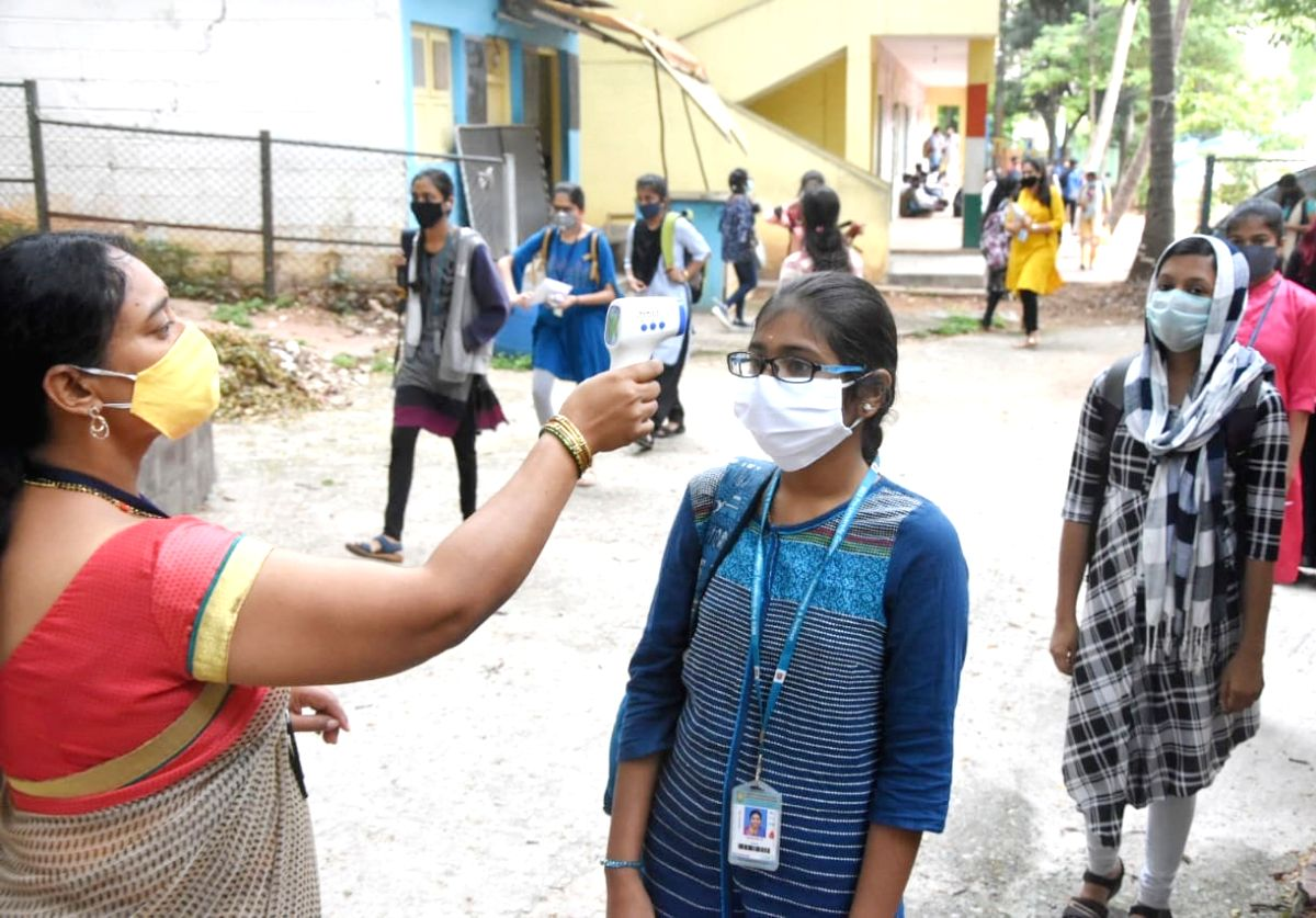 Bengaluru: A candidate undergoes COVID-19 screening as she arrives to appear for Karnataka Board Class 12 (2nd PUC) Examinations postponed due to the ongoing nationwide lockdown imposed to mitigate the spread of coronavirus, in Bengaluru on June 18,
