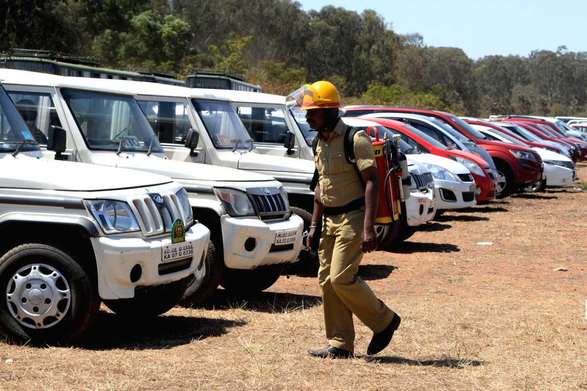Bengaluru: A firefighter patrolling at the site after a fire broke out at the parking lot in front of Yelahanka Air Force Station gutting 300 cars, in Bengaluru, on Feb 24, 2019.