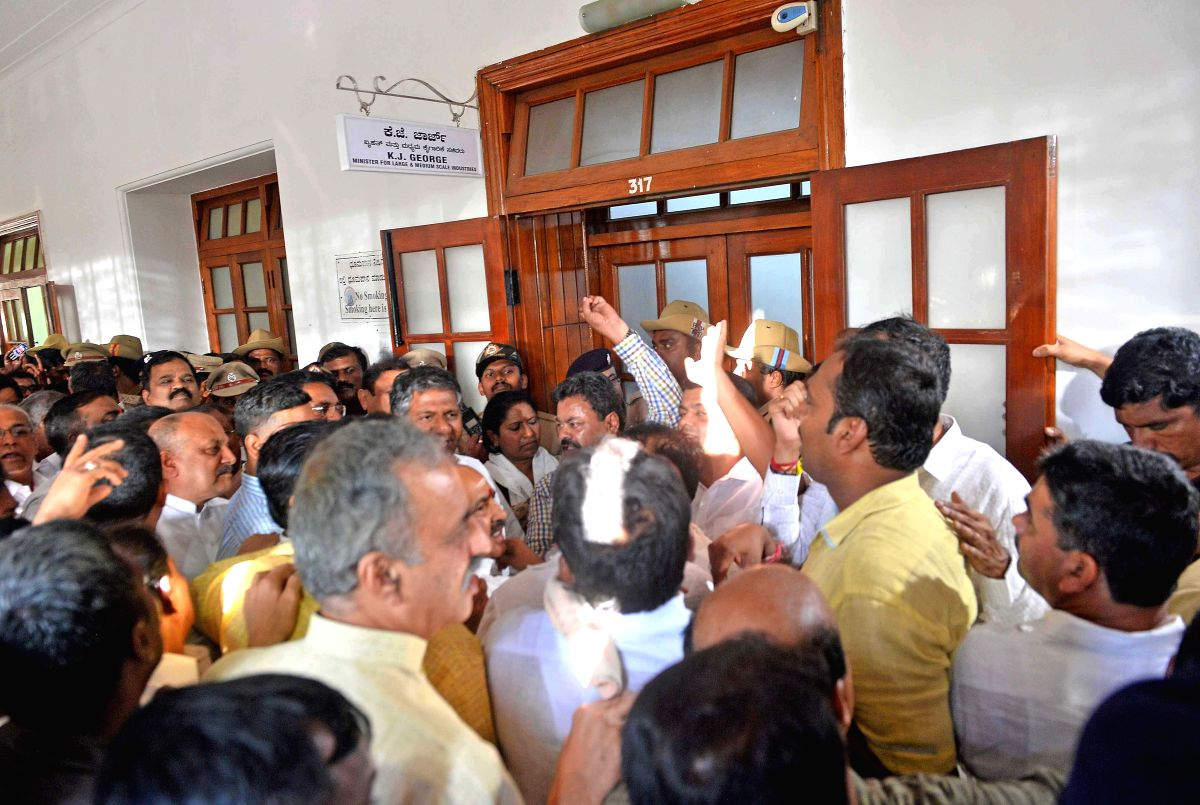 Bengaluru: BJP leaders stage a protest in front of Karnataka Minister K J George's chamber in at Vidhana Soudha, in Bengaluru on July 10, 2019. This comes after Chikballapur MLA K. Sudhakar and Hoskote MLA and Housing Minister M.T.B. Nagaraj handed o