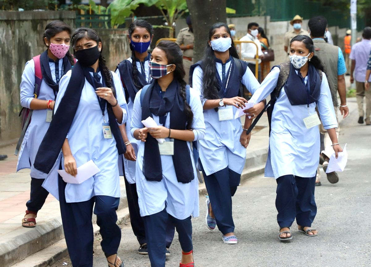 Bengaluru: College students arriving to attend the classes after the Karnataka government reopened the schools and colleges (9th to 12th classes) amid the Coronavirus pandemic in Bengaluru on Monday, August 23, 2021.