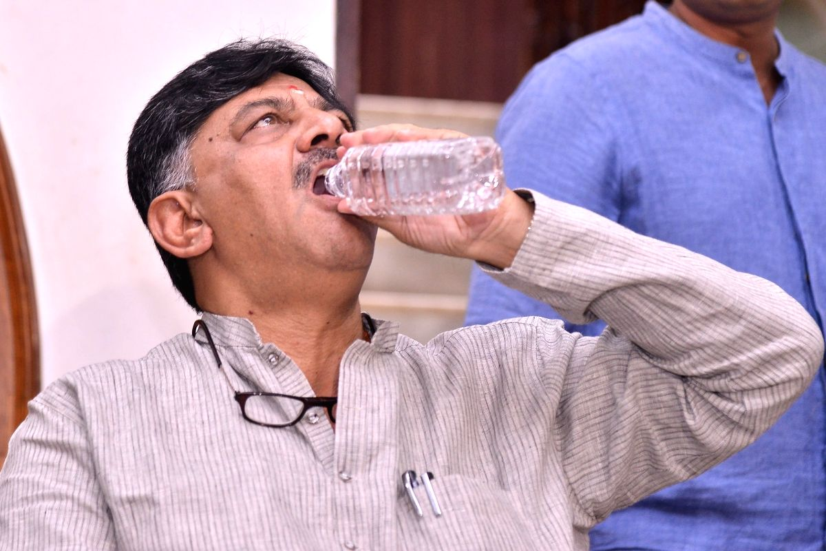 Bengaluru: Congress leader D.K. Shivakumar sips water during a press conference at his residence in Bengaluru on Aug 30, 2019.