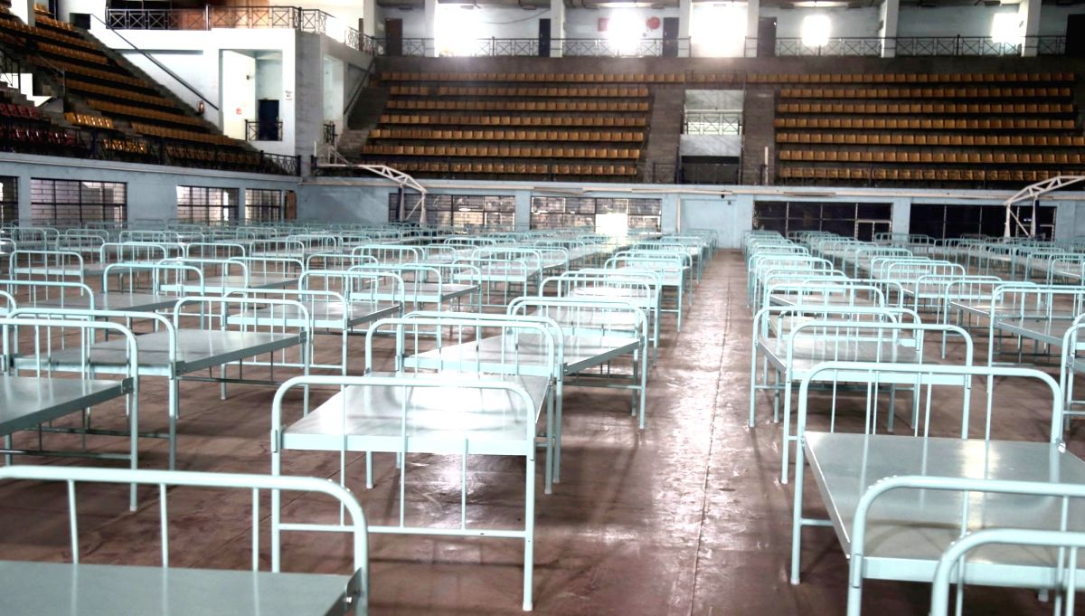 Bengaluru: Covid care centre set up at Koramangala indoor stadium, in Bengaluru on Thursday 18th March 2021.(Photo:IANS/Dhananjay Yadav)