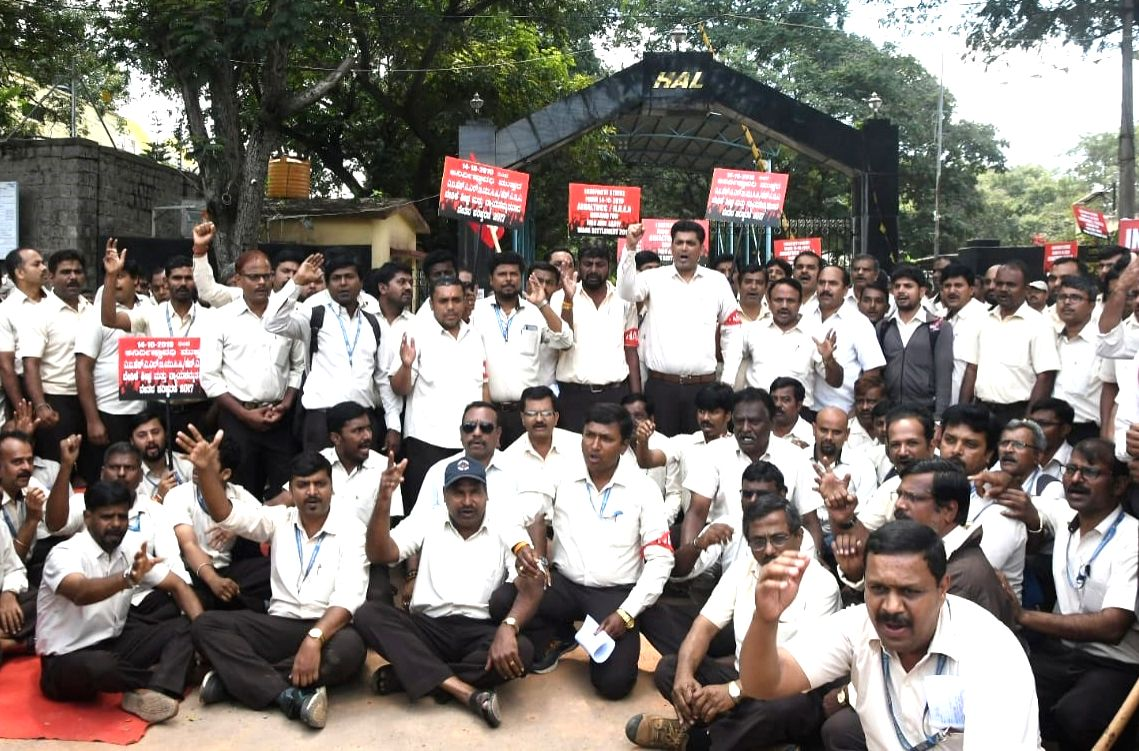 Bengaluru: Employees of the state-run Hindustan Aeronautics Ltd (HAL) participate in an indefinite strike over wage revision and other demands, in Bengaluru on Oct 14, 2019.