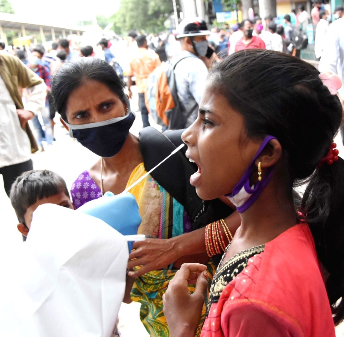 Bengaluru: Health worker collect swab samples for COVID-19 tests at City Railway station, Majestic, amid surge in coronavirus cases, in Bengaluru on Saturday, June 26, 2021