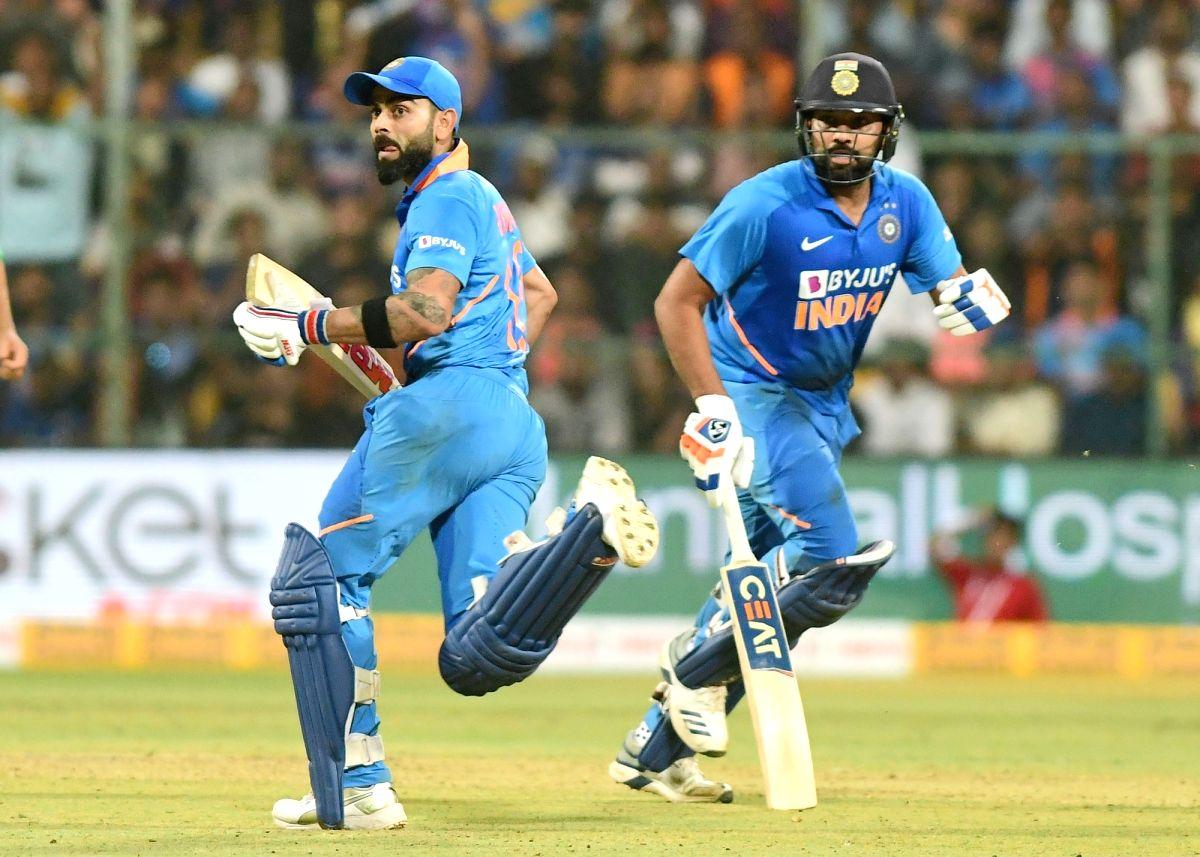 Bengaluru: India's Virat Kohli and Rohit Sharma run to take wickets during the third and final ODI match between India and Australia, at M. Chinnaswamy Stadium in Bengaluru on Jan 19, 2020.