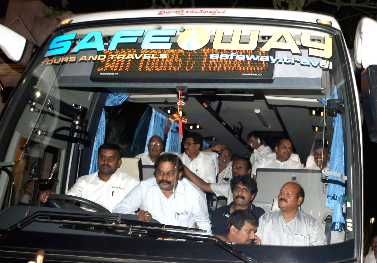 Bengaluru: JD(S) MLAs leaving in a bus from Hotel Taj West End to a resort in Kodagu following the political developments in Karnataka, in Bengaluru on July 8, 2019.