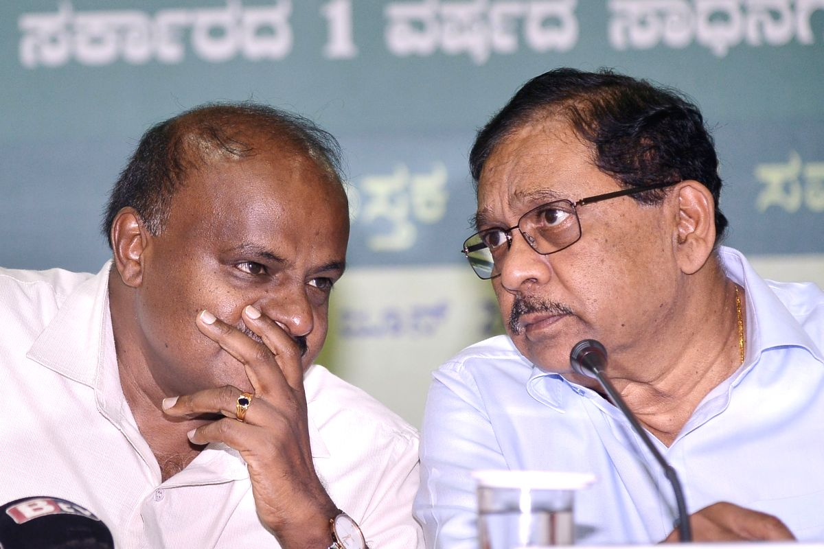 Bengaluru: Karnataka Chief Minister H.D. Kumaraswamy and Deputy chief minister G Parameshwara release hand outs on completion of one year of coalition government in Bengaluru on June 20, 2019.