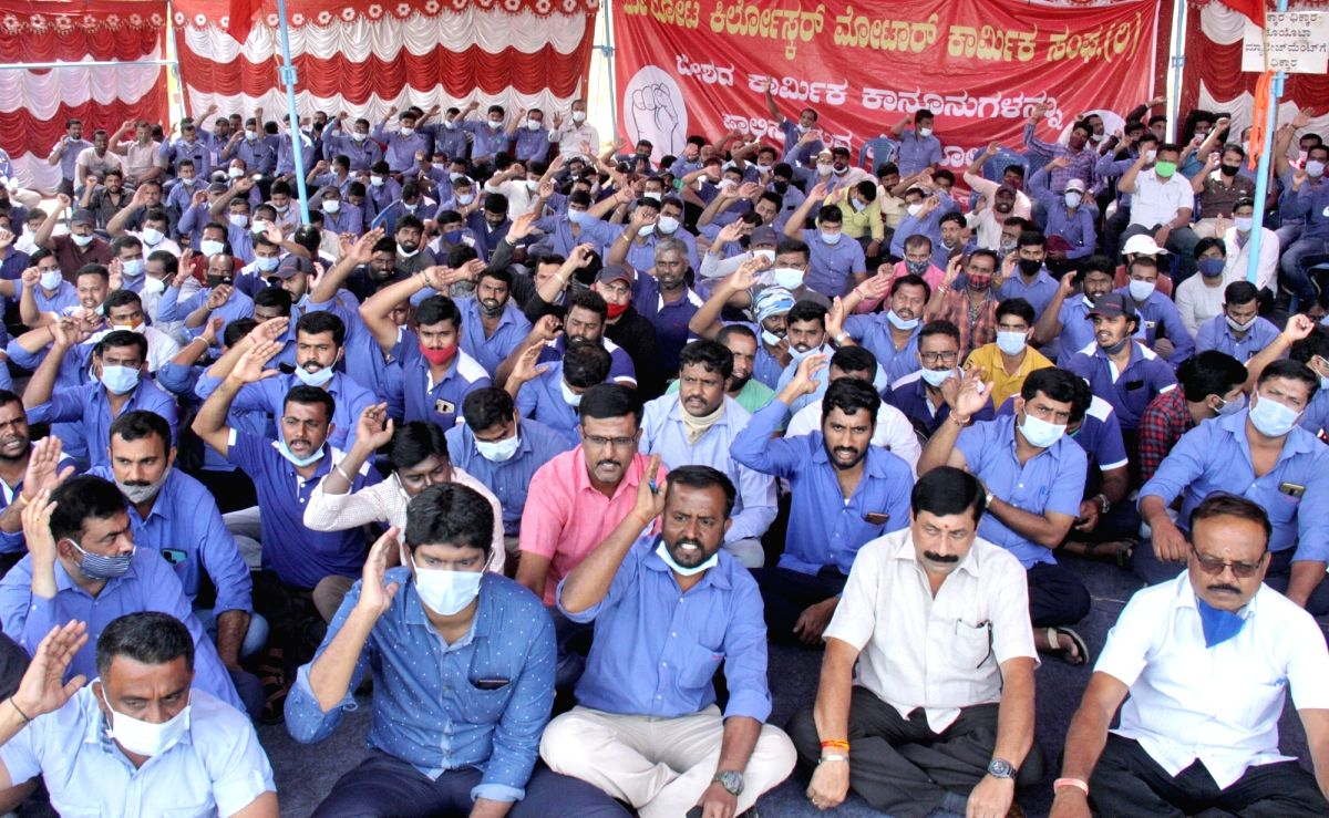 Bengaluru: Members of Toyota Kirloskar Motor Workers Association stage a sit-in demonstration at Toyota Kirloskar Motor Pvt Ltd (TKML) premises to protest against TKML management, in Bidadi on the outskirts of Bengaluru on Nov 11, 2020.