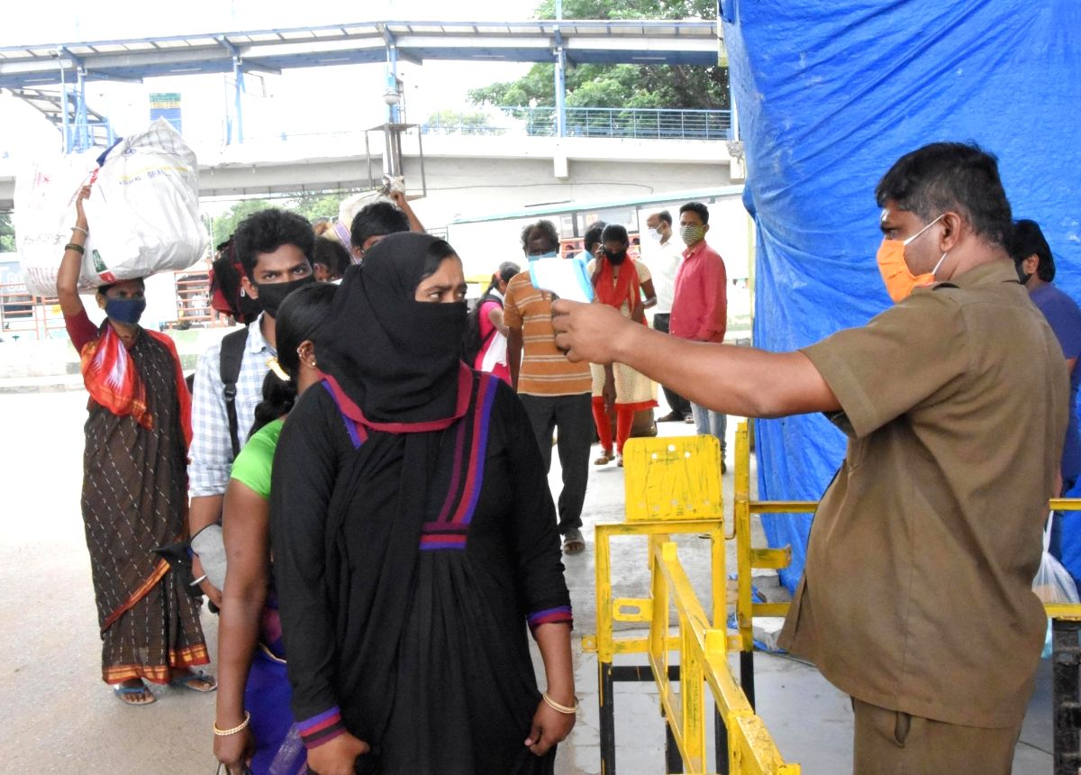 Bengaluru: Migrants being screened for the symptoms of COVID-19 as they arrive at a bus depot to head back to their native villages after the Bengaluru district authorities re-imposed lockdown across the city from Tuesday to July 22 for containing th