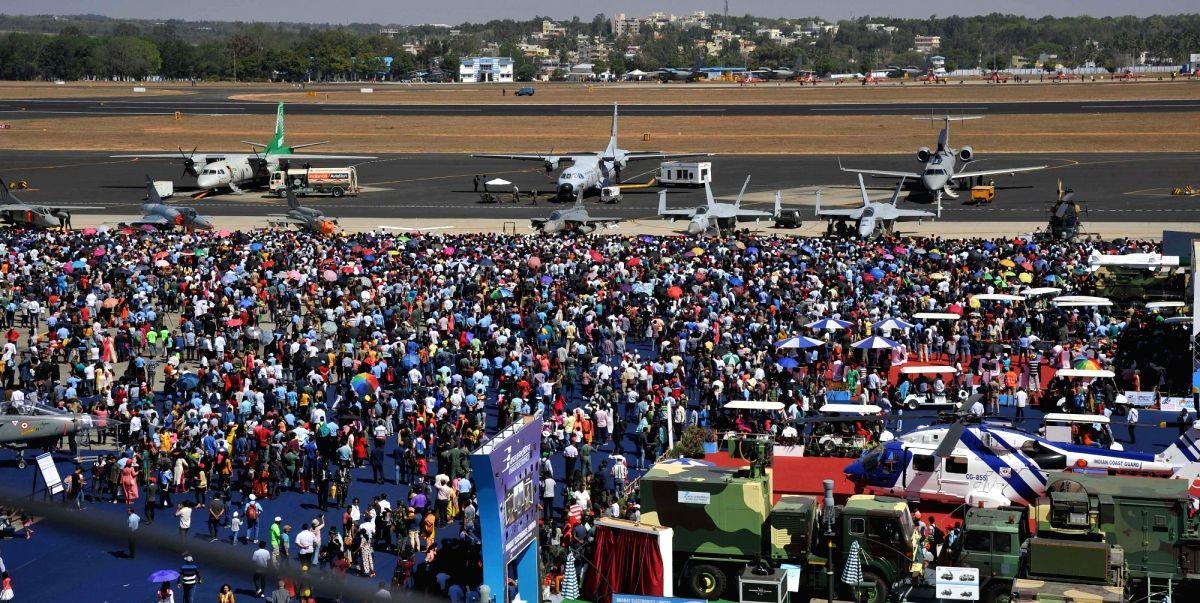 "People at Yelahanka Air Force Station during the ""Aero India 2019"" - air show, in Bengaluru"
