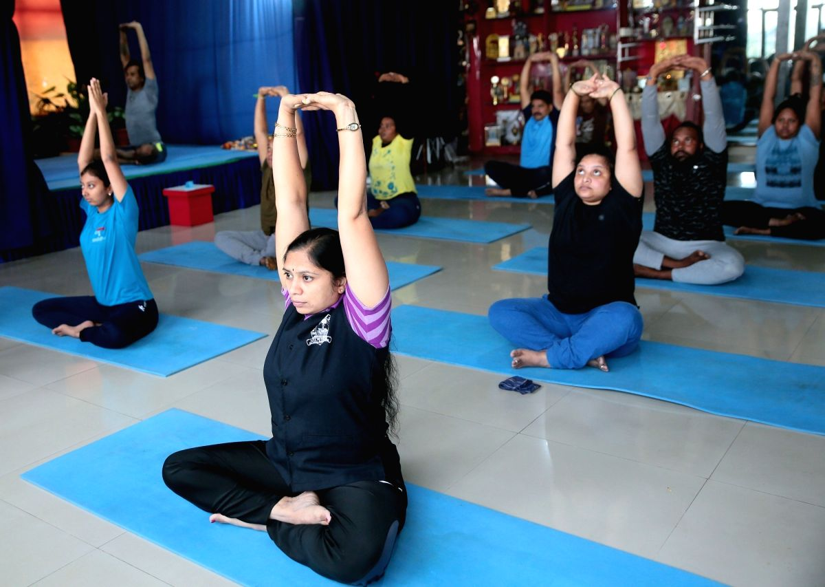 Bengaluru: People perform yogic asanas at SGS International Yoga Foundation centre after yoga centres and gyms re-opened as a part of the third phase of easing of COVID-19 lockdown, in Bengaluru on Aug 5, 2020.