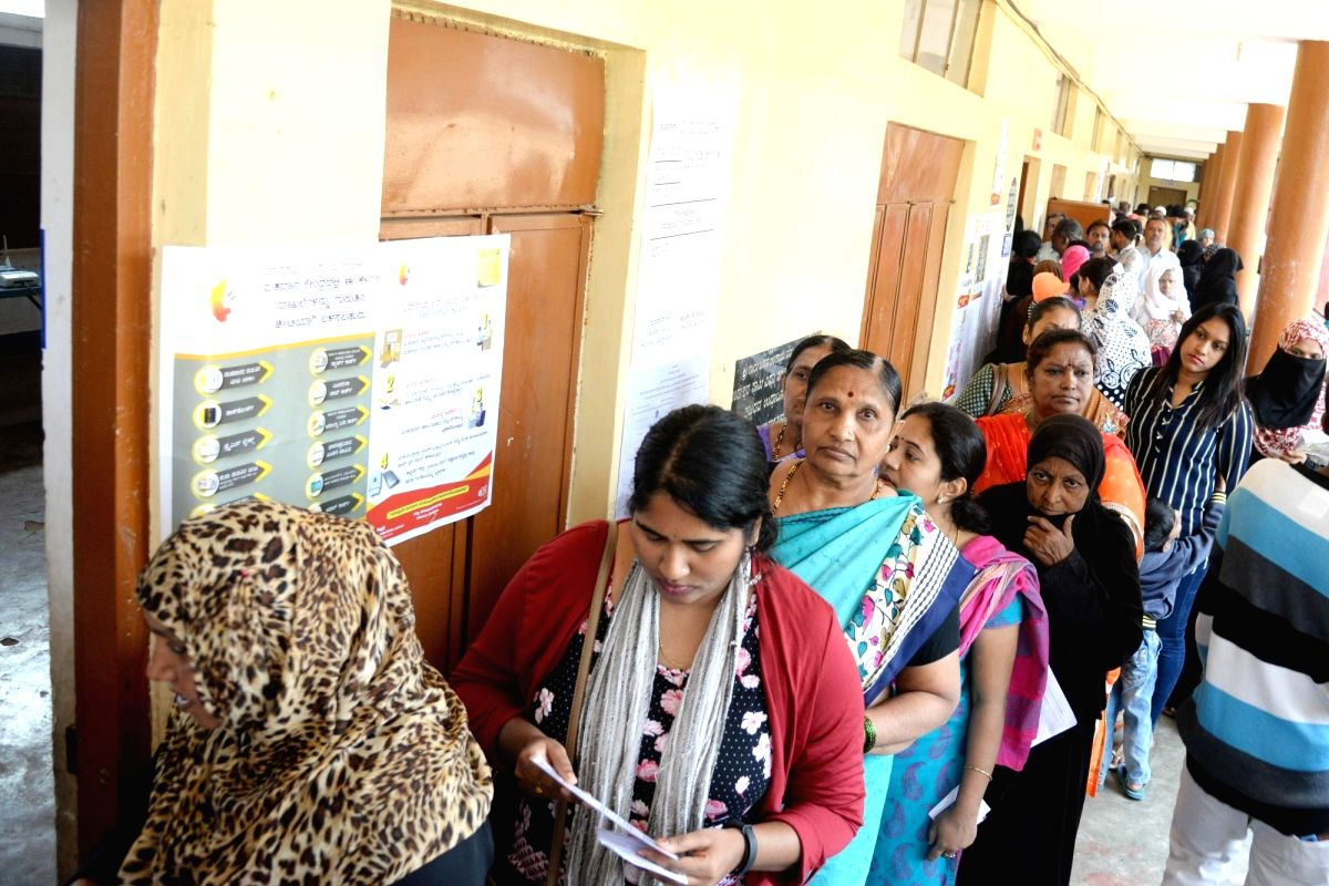 Bengaluru: People stand in the queue at Yeshwantha Pura constituency to cast their vote for Karnataka bye-polls in Bengaluru on Dec 5, 2019.