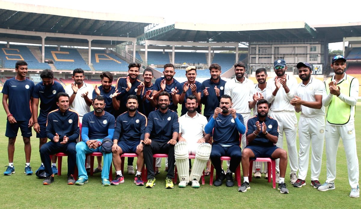 Bengaluru: Players of Saurashtra pose for a group photograph after winning the 2nd semi-final Ranji Trophy match against Karnataka at M. Chinnaswamy Stadium in Bengaluru, on Jan 28, 2019. An unbeaten 201-run partnership between Cheteshwar Pujara and