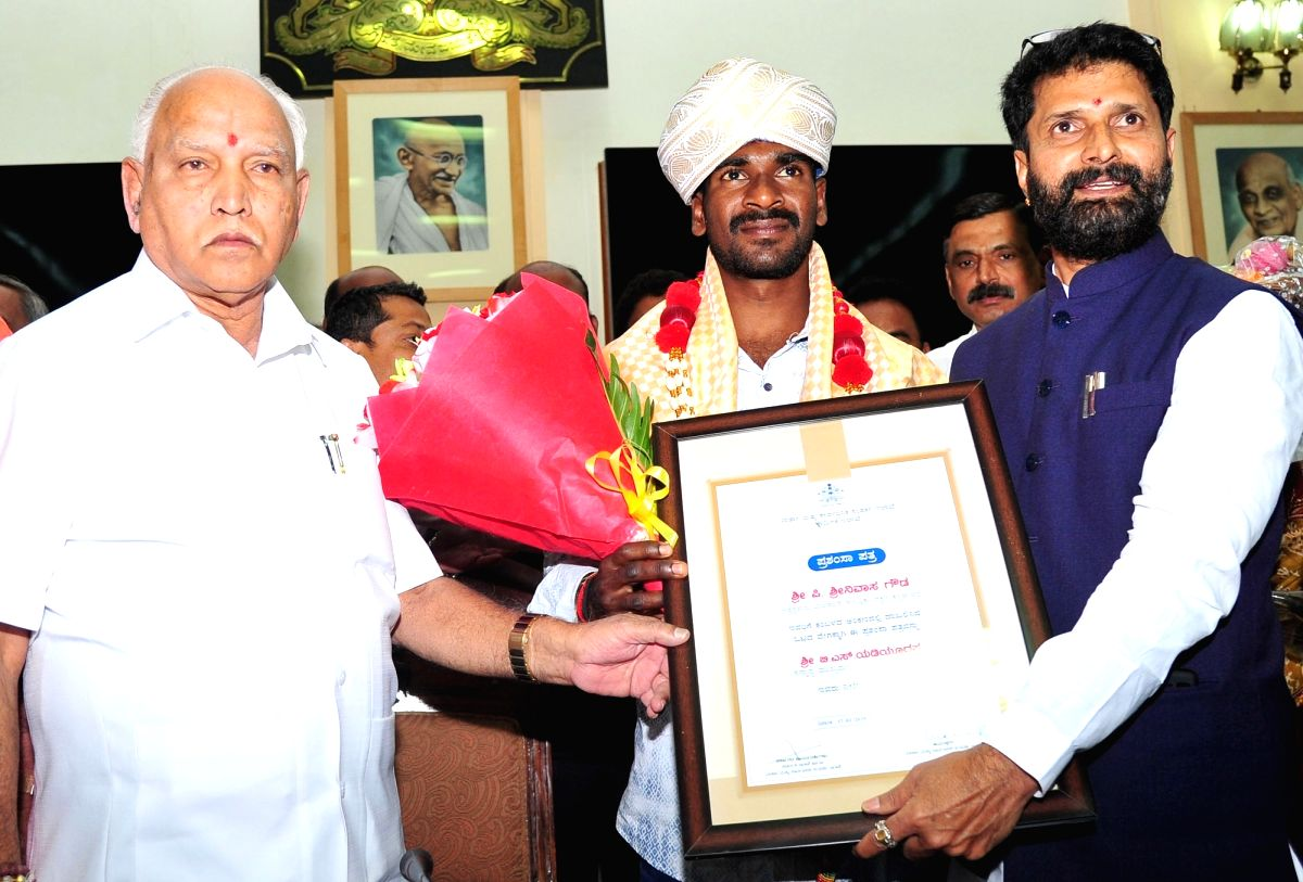 Bengaluru: Srinivasa Gowda, Karnataka Buffalo racer who has set a new record as the fastest runner in the history of the traditional sport, Kambala being felicitated by Karnataka Chief Minister BS Yediyurappa, in Bengaluru on Feb 17, 2020. (Photo:IAN