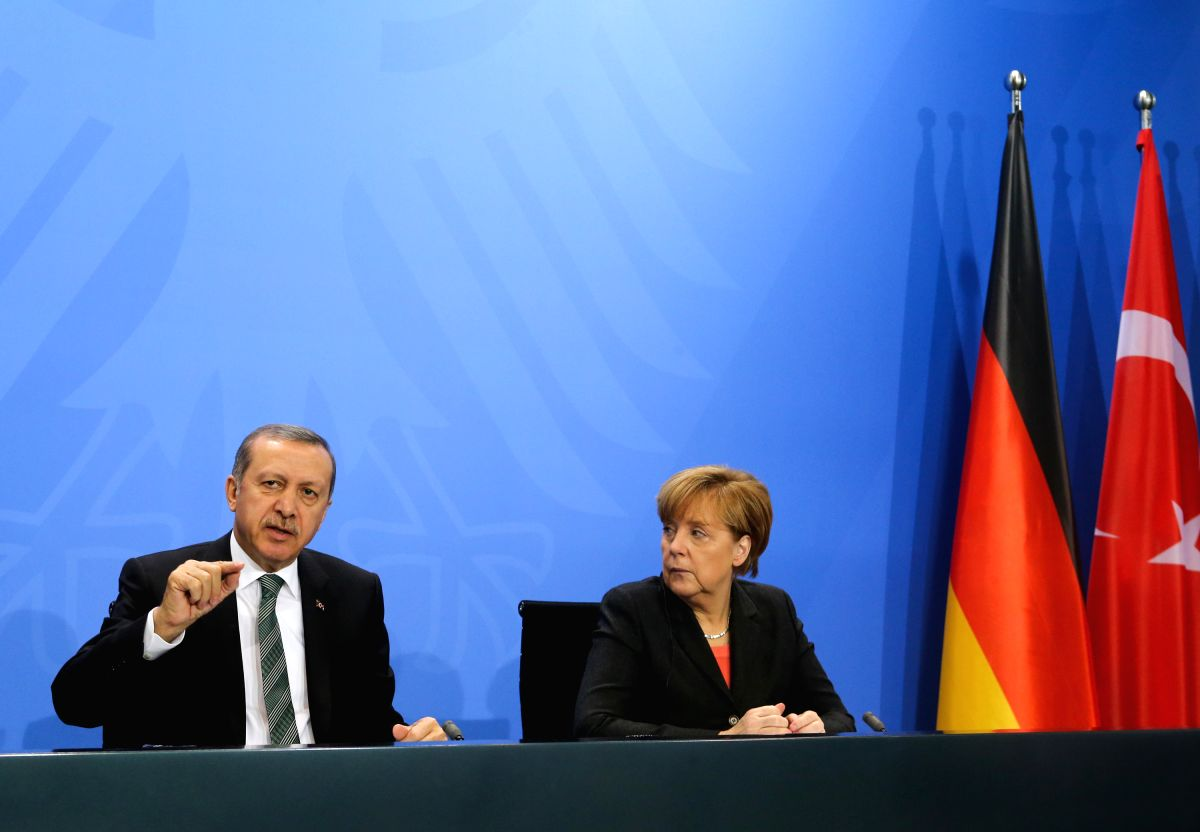 BERLIN, Feb. 4, 2014 (Xinhua) -- German Chancellor Angela Merkel (R) and Turkish Prime Minister Recep Tayyip Erdogan attend a press conference after meetings at the Chancellery in Berlin, Germany, on Feb. 4, 2014. (Xinhua/Zhang Fan/IANS) (lyx)