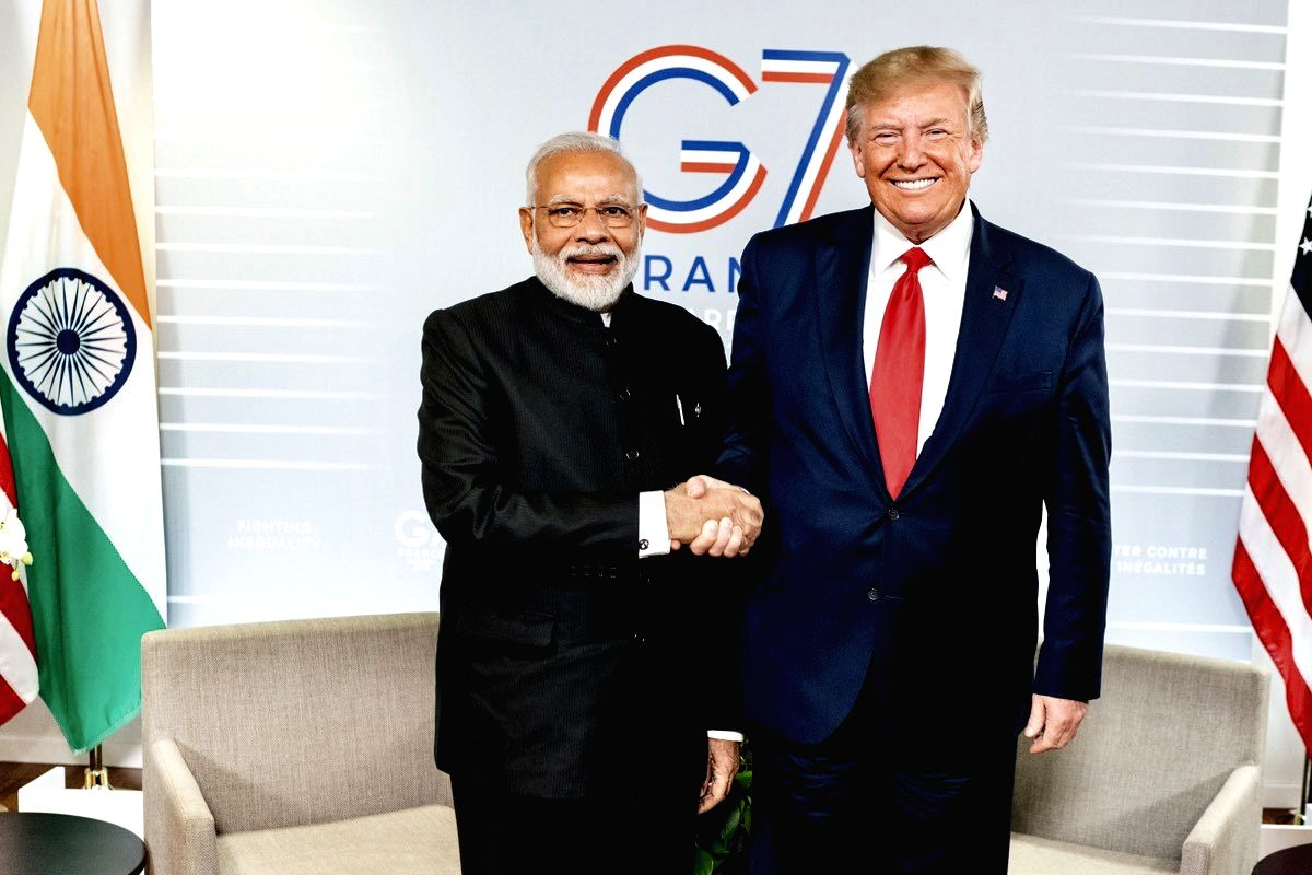 Biarritz: Prime Minister Narendra Modi meets US President Donald Trump on the sidelines of the G7 Summit in Biarritz, France on Aug 26, 2019. (Photo: IANS/MEA)