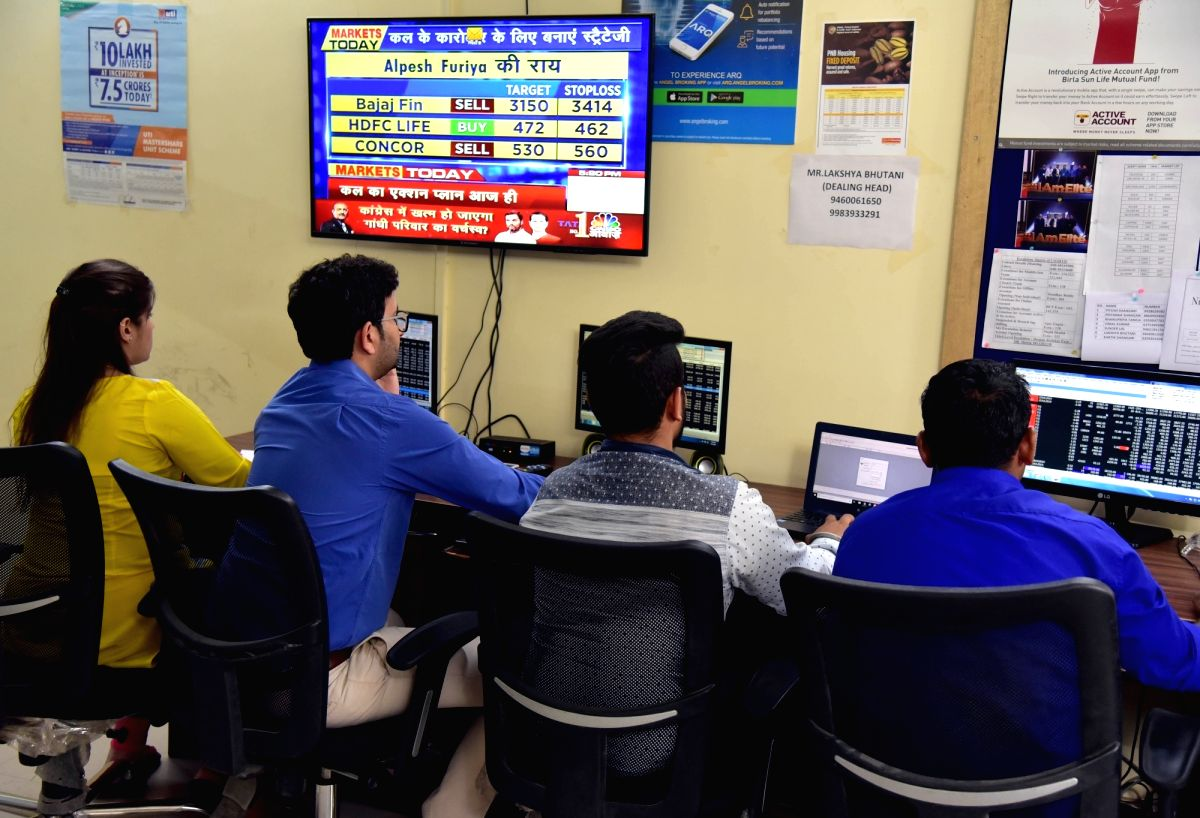 Bikaner: Stock brokers keep a close eye on share prices, in Bikaner on July 8, 2019. Disappointment over the Budget proposals and muted global markets led the Sensex to log the heaviest fall in seven months on Monday. Both the key equity indices -- S