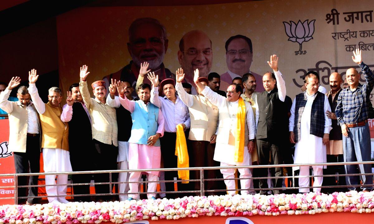 "Bilaspur: BJP National Working President J.P. Nadda with Himachal Pradesh Chief Minister Jai Ram Thakur and State BJP Spokesperson Randhir Sharma during ""Abhinandan Samaroh"" organised to welcome Nadda, at Luhnu Ground in Bilaspur on Oct 7, 2019. (Pho"