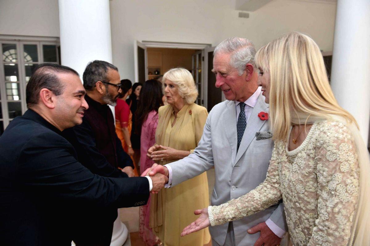 Billionaire diamond trader Nirav Modi (R) shakes hands with TRH Charles, Prince of Wales and Camilla, Duchess of Cornwall. (Image Source: IANS)