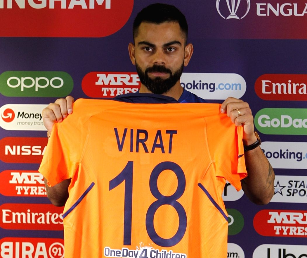 Indian captain Virat Kohli unveils the new new 'away jersey' of team India which has splattering of orange on the shoulders and the back.