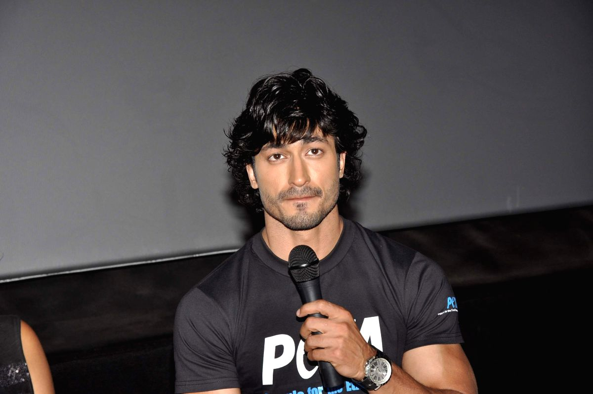 Bollywood actor Vidyut Jammwal poses during the unveiling of PETA (People for Ethical Treatment of Animals), new pro veg ad at PVR in Mumbai on April 11, 2013.