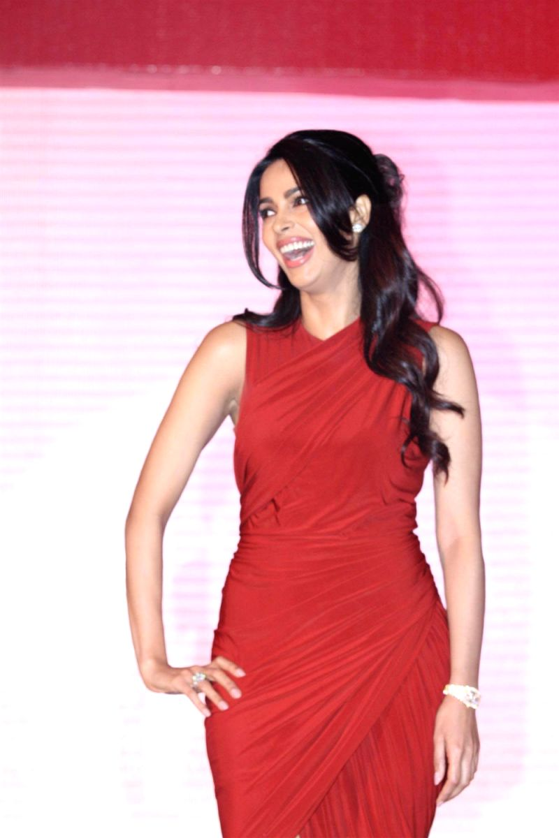 Mallika Sherawat looks like a lovely swizzle berry in this outfit