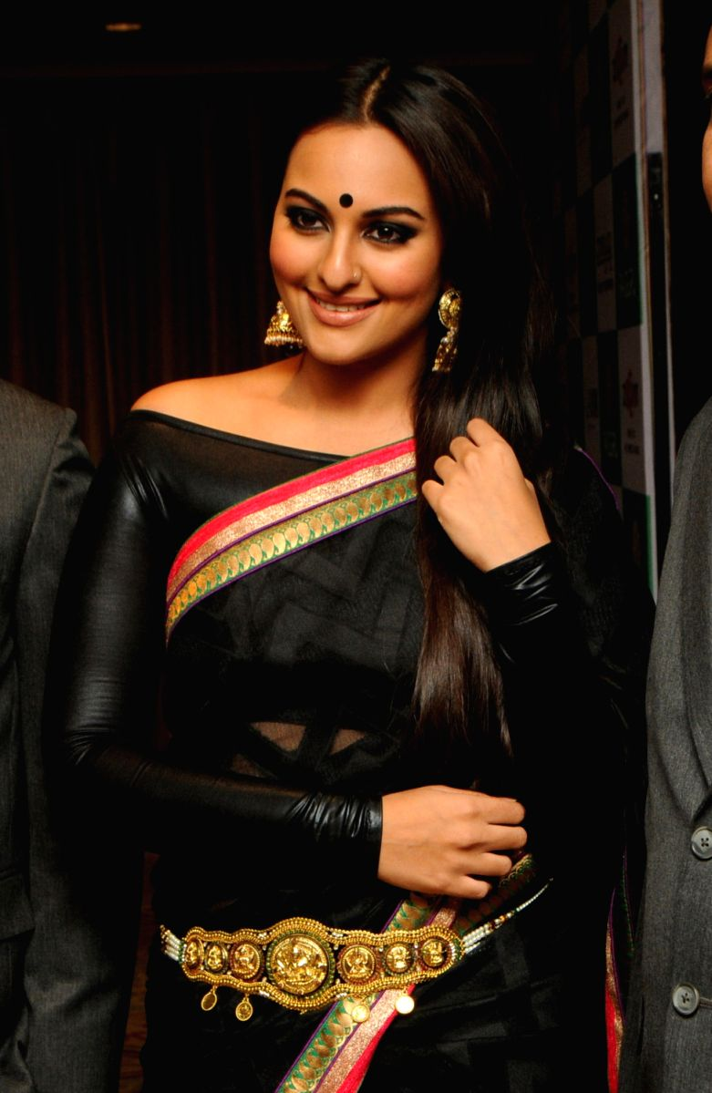 Biker chick gone Desi - Sonakshi pairs a black chiffon saree with a leather blouse. Plus points for the Kamarbandh.