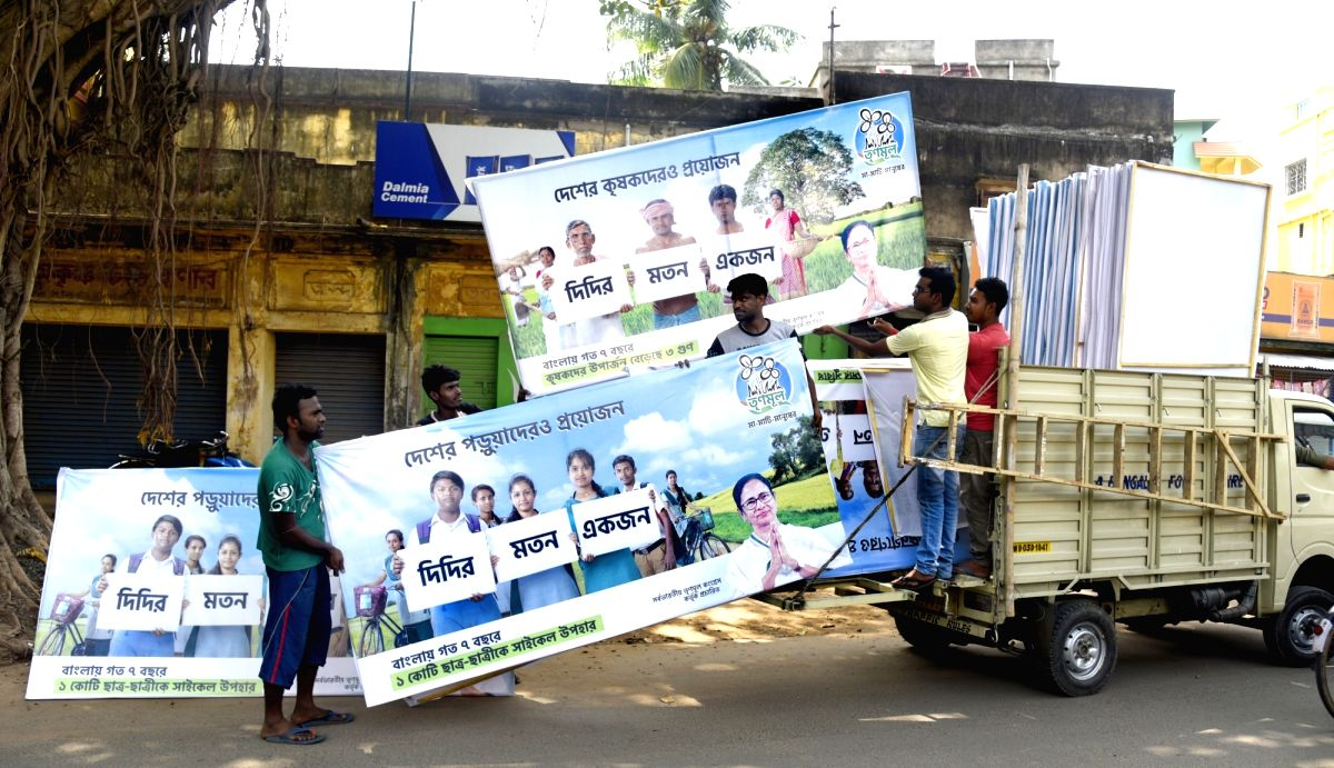 Bolpur: TMC banners being put up on Bolpur streets as part of election campaigning for the 2019 Lok Sabha elections in West Bengal's Bolpur, on April 11, 2019. (Photo: Indrajit Roy/IANS)