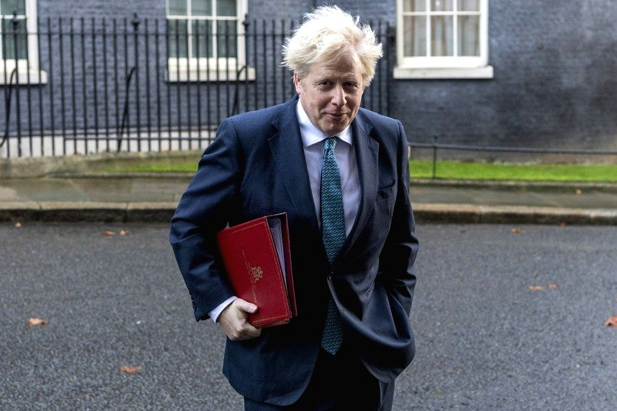 Britain, Dec. 17 (Xinhua) -- British Prime Minister Boris Johnson leaves 10 Downing Street to attend a cabinet meeting in London, Britain, on Dec. 15, 2020.  (Photo by Ray Tang/Xinhua/IANS)