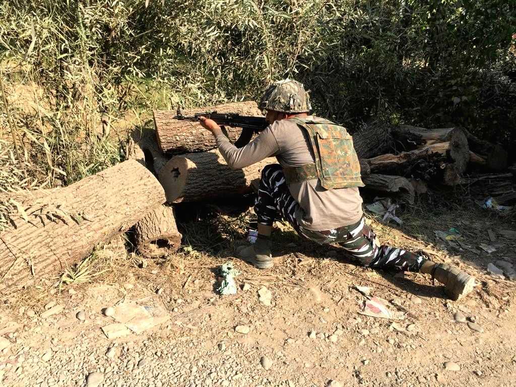 Budgam: A soldier takes position during an encounter between terrorists and security forces that started in central Kashmir's Budgam district on Oct 16, 2020. The gunfight began at Chadoora after a cordoning operation was launched in the area during