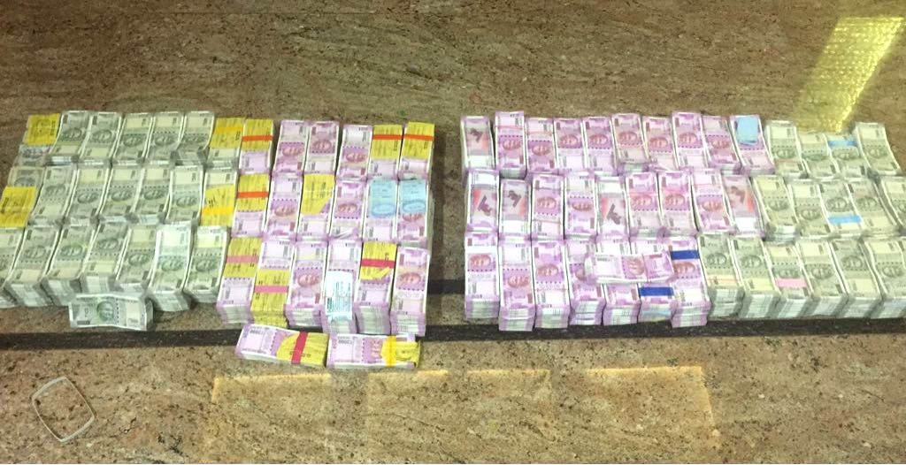 Bundles of unaccounted cash in Rs 2,000 and Rs 500 notes seized from the lockers of contractors at Mysuru in Karnataka.