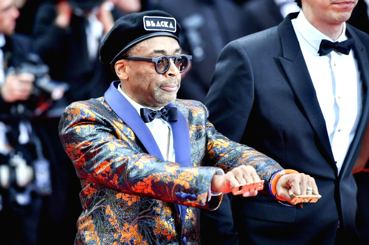 "CANNES, May 14, 2018 (Xinhua) -- Director Spike Lee poses on the red carpet for the premiere of the film ""BlacKkKlansman"" during the 71st Cannes International Film Festival in Cannes, France, on May 14, 2018. The 71st Cannes International Film Festiv"